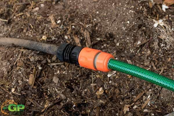 Garden hose connected to weeping hose